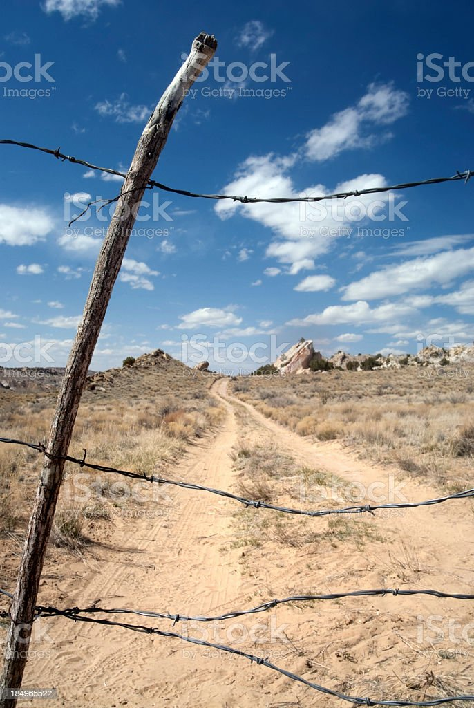 Barbed Wire Desert Landscape Road Stock Photo & More Pictures of ...