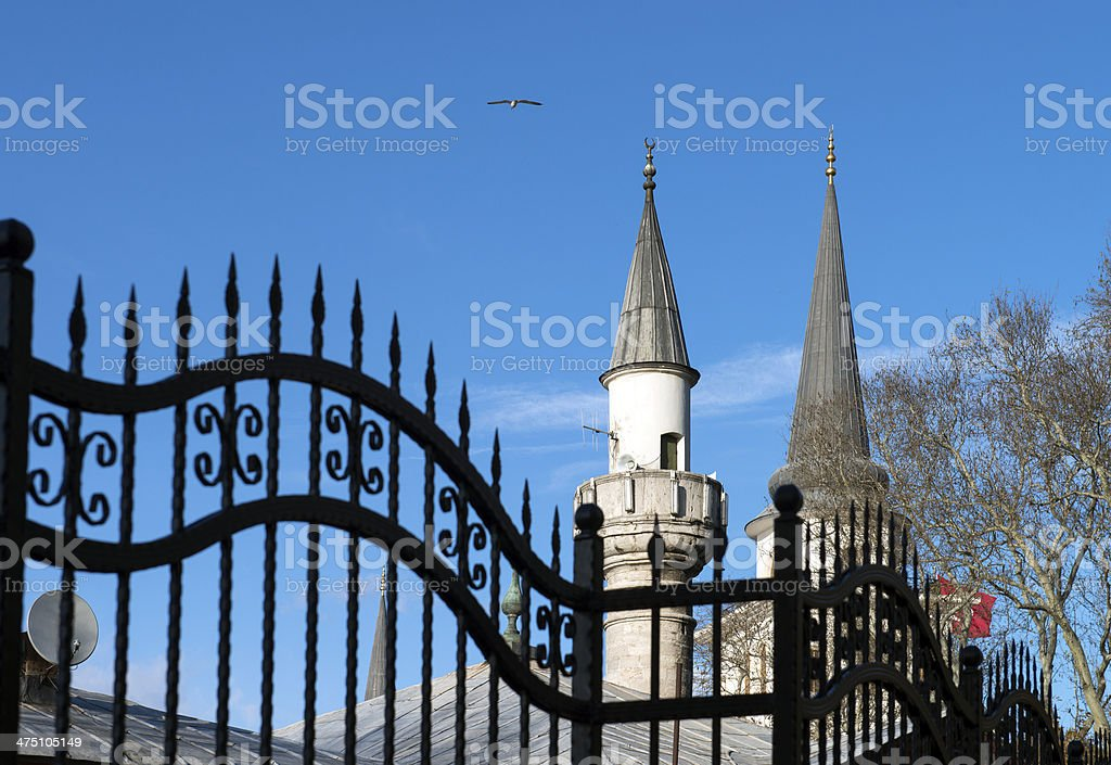 Barbed Wire Fence and Minaret royalty-free stock photo