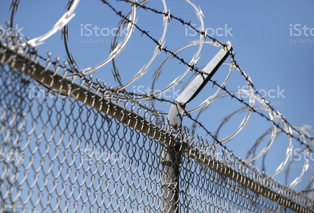 Barbed wire fence for security royalty-free stock photo