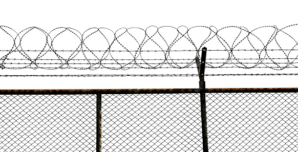 istock Barbed wire fence 1061631074