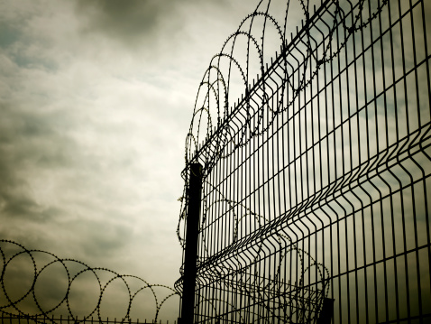 istock Barbed wire fence 160889846