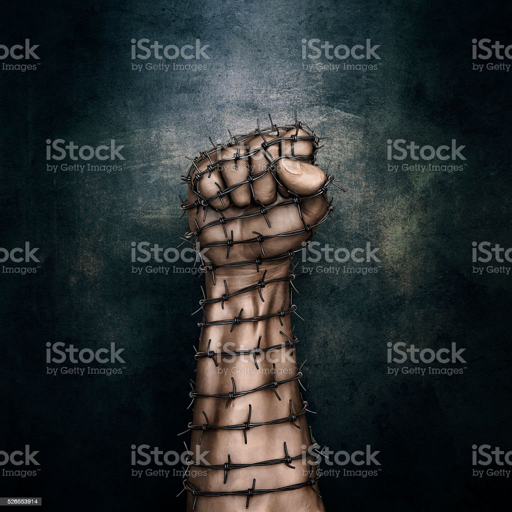 Barbed wire fist stock photo