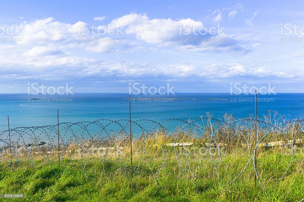 Barbed wire, Floating platforms, Mulberry Harbour in Arromanches stock photo