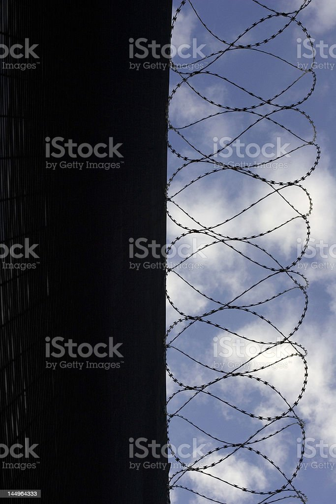 barbed wire in prison stock photo