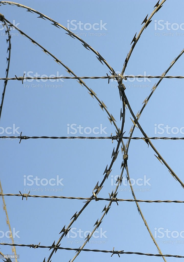 Barbed wire in the blue sky royalty-free stock photo