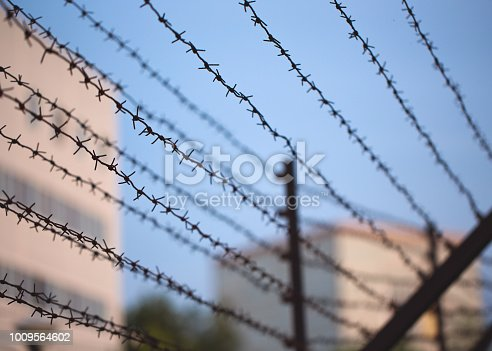 Barbed wire border along private property