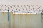 istock barbed wire on wall 505253029