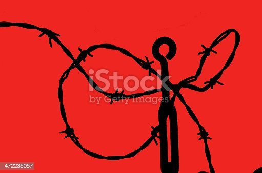 istock Barbed Wire Silhouetted -  abstract 472235057