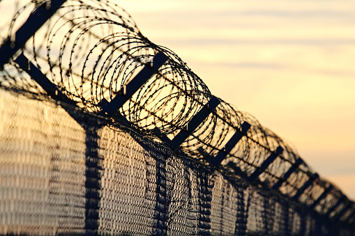 istock barbed wire steel wall against the immigrations in europe 643293802