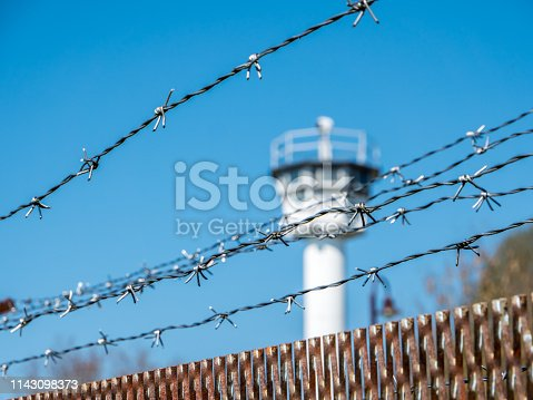 Barbed wire with German watchtower border