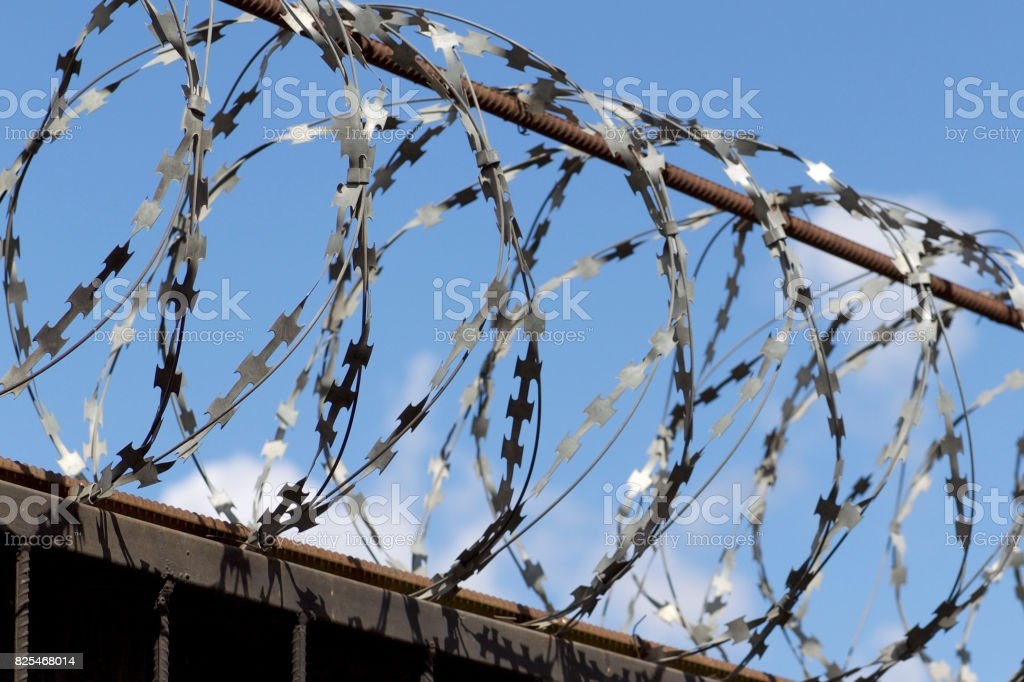 Barbed Wire Wound To The Top Of A Fence Stock Photo & More Pictures ...