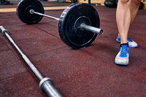 istock Barbel on the floor in the cross training box. Concept of the cross trainingtraining, online qualifiers for the cross trainingchampionships 1192053425