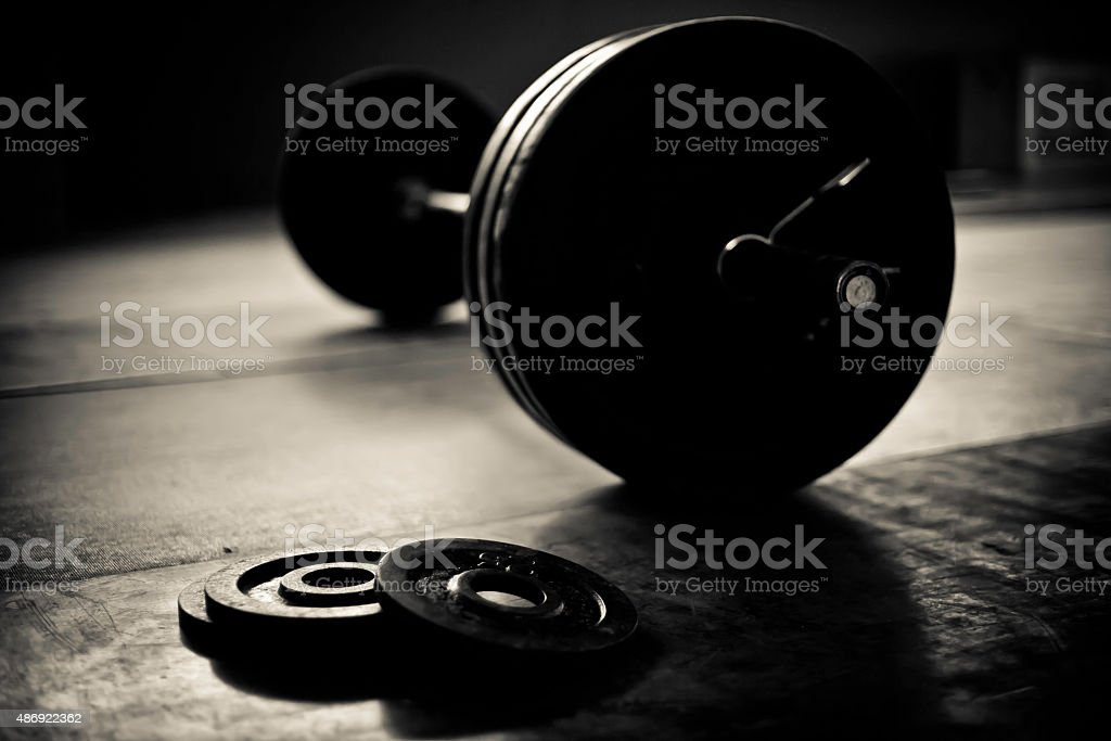 Barbell and discs in a weightlifting gym stock photo