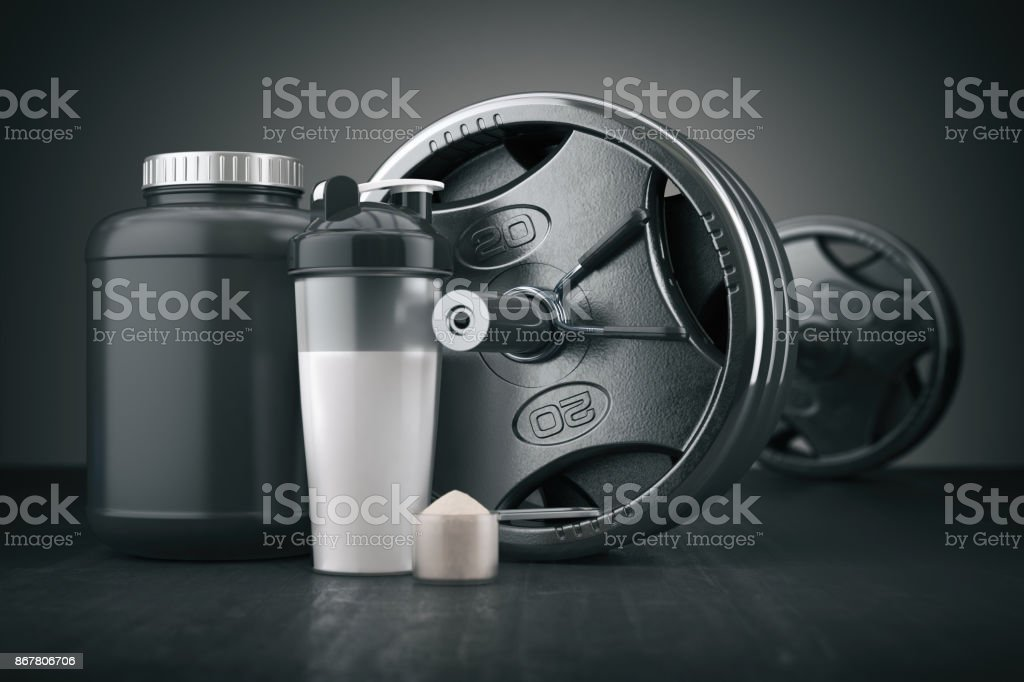Barbell and whey protein shaker. Sports bodybuilding supplements or nutrition. Fitness or healthy lifestyle concept. stock photo