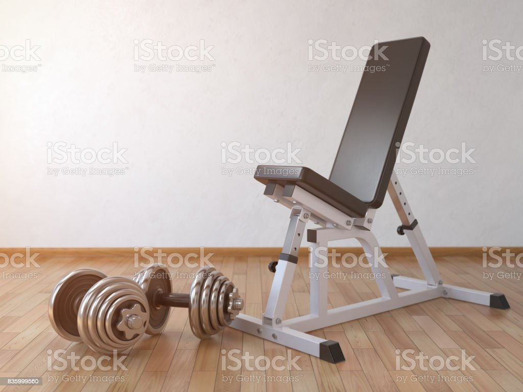 Barbell bench with weight dumbbells in the home. stock photo