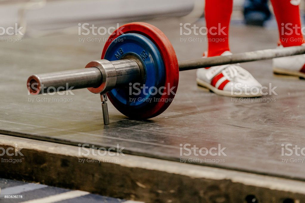 barbell for deadlift on athletic training platform stock photo