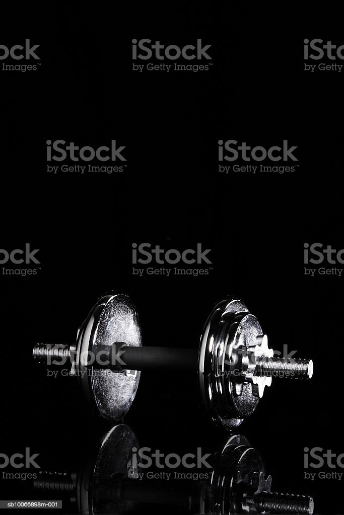 Barbell on black background royalty-free stock photo