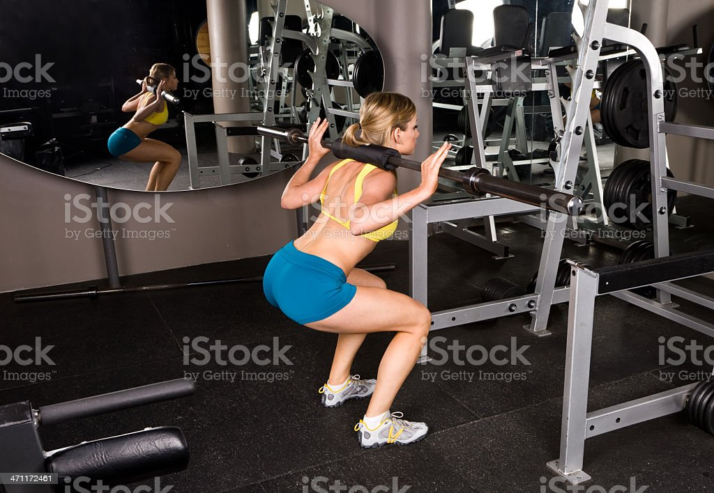 Barbell squats royalty-free stock photo