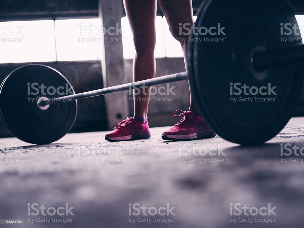 Barbell Weights With A Woman Standing In Pink Sneakers Royalty Free Stock Photo