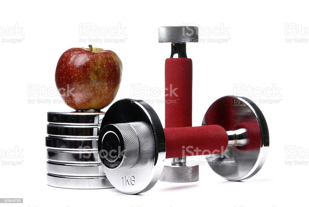 Barbells and apple isolated stock photo