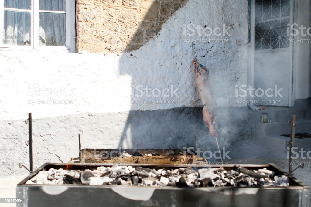 barbeque and lamb on spit on fire outdoors royalty-free stock photo