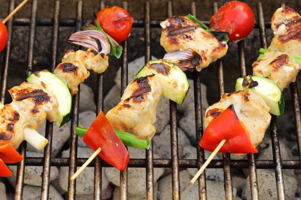 Barbeque barbecue skewers - summer food Summer is food on barbeque for dinner. barbecue skewers with pork, chicken, pepper fruit and tomato pejft stock pictures, royalty-free photos & images