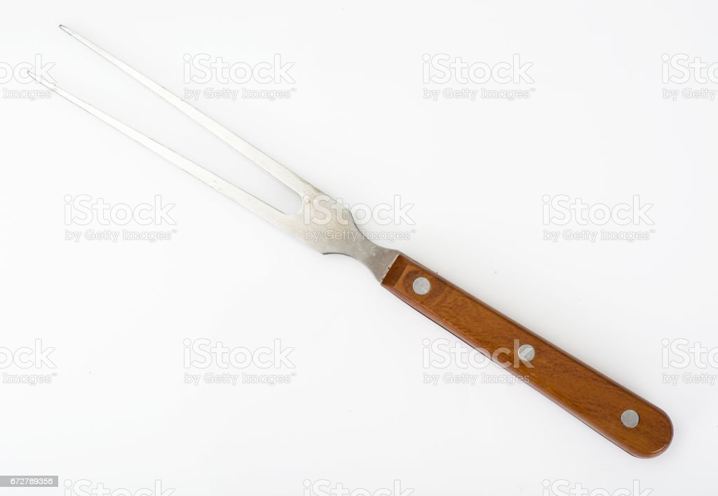 Barbeque fork with wooden handle stock photo
