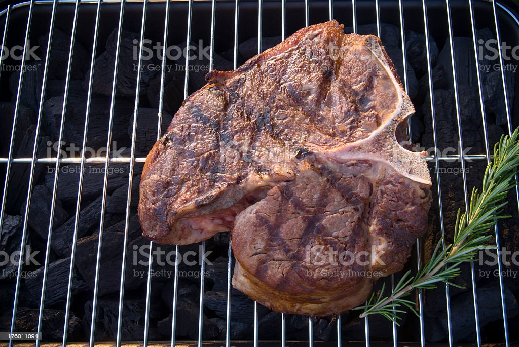 Barbeque Grill Background & Grilled Meat, Beef Porterhouse T-Bone Strip Steak royalty-free stock photo