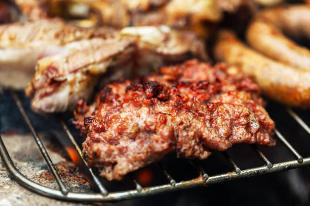 Barbeque grill mixed meat cooking on open air stock photo