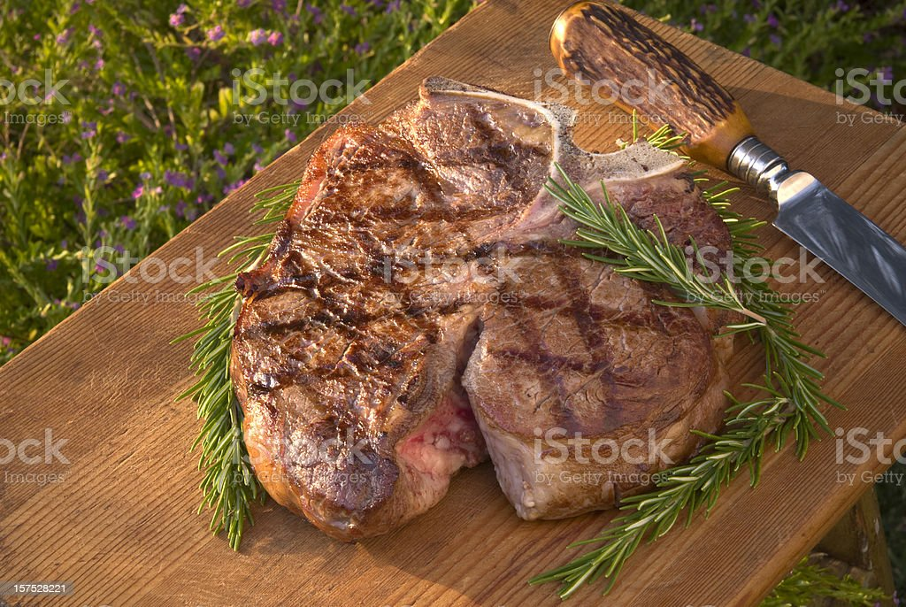 Barbeque Grilled Meat; Cooked Porterhouse T-Bone Beef Steak & Rosemary royalty-free stock photo