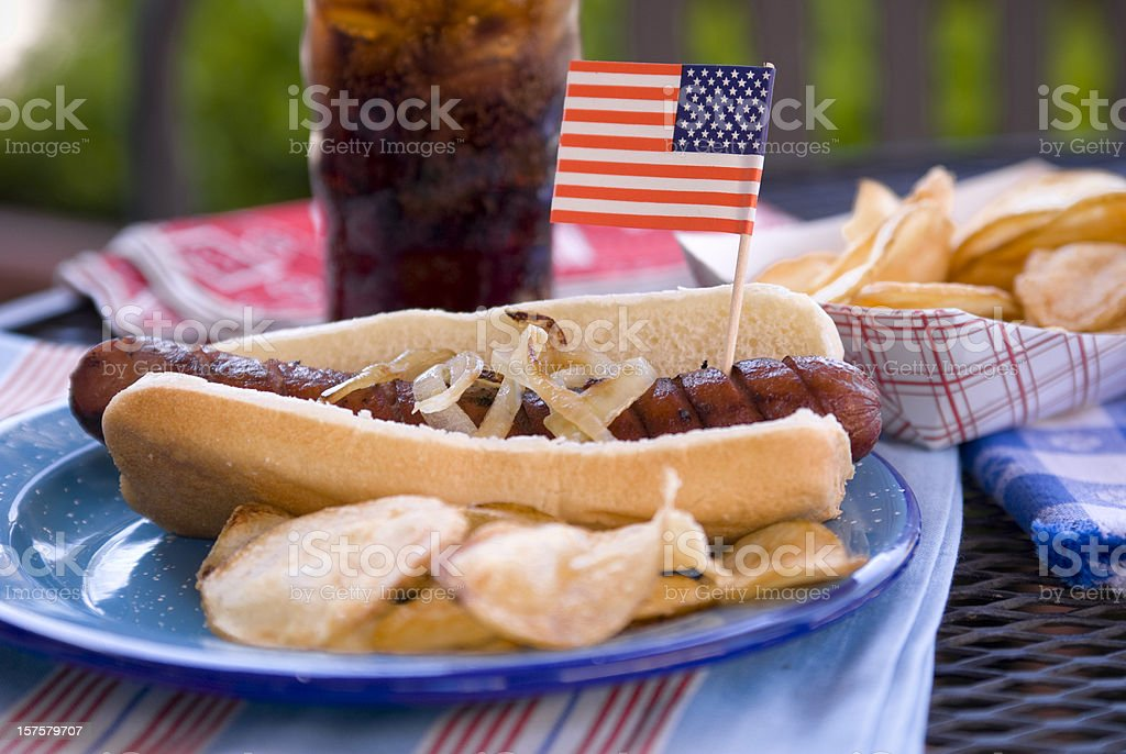 Barbeque Hot Dog & Patriotic American Food & Picnic Table royalty-free stock photo