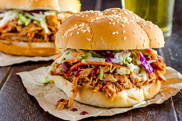 barbeque pulled pork sandwiches - coleslaw stock pictures, royalty-free photos & images