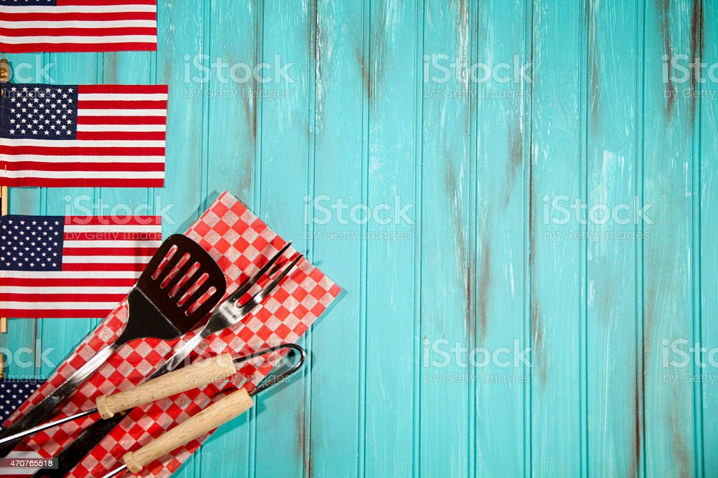 Barbeque Utensils On Checked Cloth Usa Flags Blue Wooden