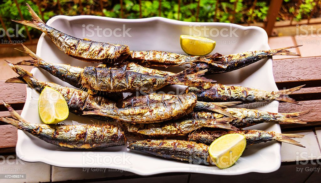 Barbequed Sardines on white plate. stock photo
