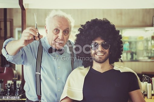 Barber and his client in a barber shop