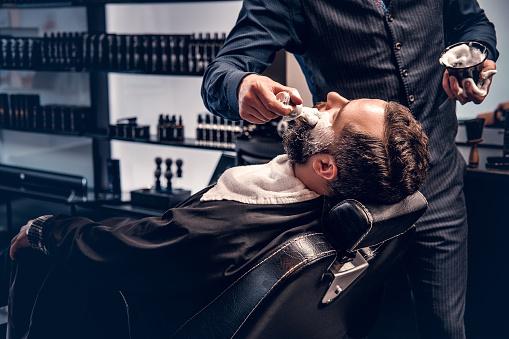 istock Barber applies shaving foam 987634696