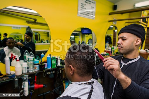 istock Barber Giving his Client a Haircut, In Barber Shop 502351860