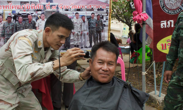 Barber haircut free to the public at the event. stock photo