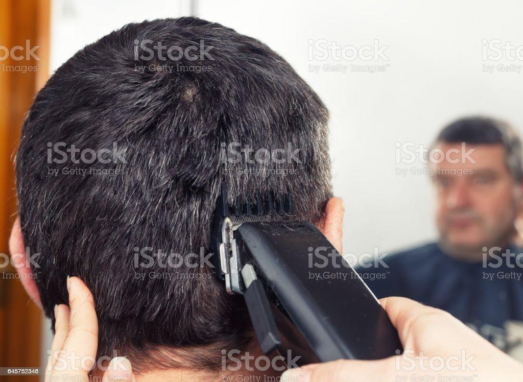 barber making haircut to man stock photo