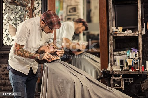 istock Barber man grooming with scissors of real hipster 1178570610