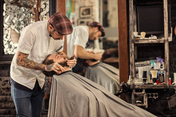 Barber man grooming with scissors of real hipster stock photo