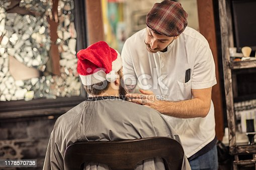 istock Barber man grooming with scissors of real hipster 1178570738