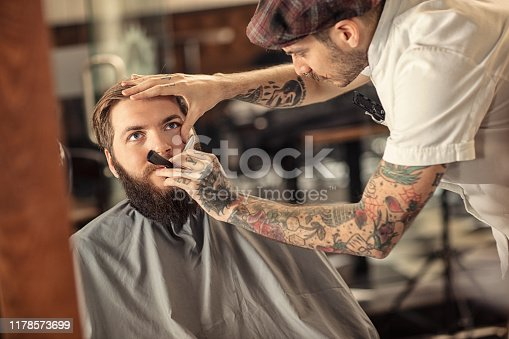istock Barber man grooming with scissors of real hipster 1178573699