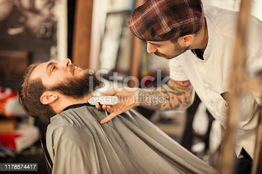 istock Barber man grooming with scissors of real hipster 1178574417