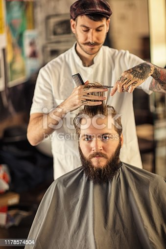 istock Barber man grooming with scissors of real hipster 1178574504