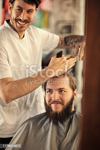 istock Barber man grooming with scissors of real hipster 1178574672