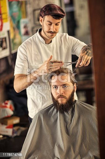 istock Barber man grooming with scissors of real hipster 1178574748