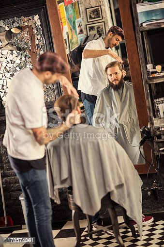 istock Barber man grooming with scissors of real hipster 1178574861