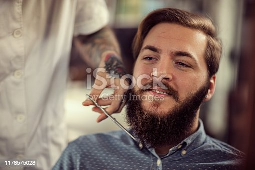 istock Barber man grooming with scissors of real hipster 1178575028