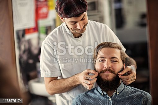 istock Barber man grooming with scissors of real hipster 1178575174